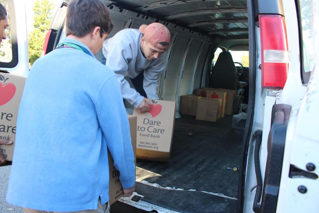 Trinity students help load food items into the Dare to Care truck. In addition to the food, Trinity donated more than $7,000. photo by Tyler Harris